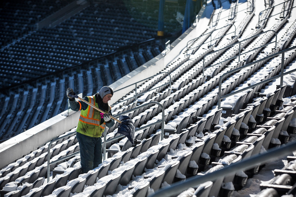 . A crew member works to remove snow from MetLife Stadium, which will host Superbowl XLVIII next month, on January 22, 2014 in East Rutherford, New Jersey.  (Photo by Andrew Burton/Getty Images)