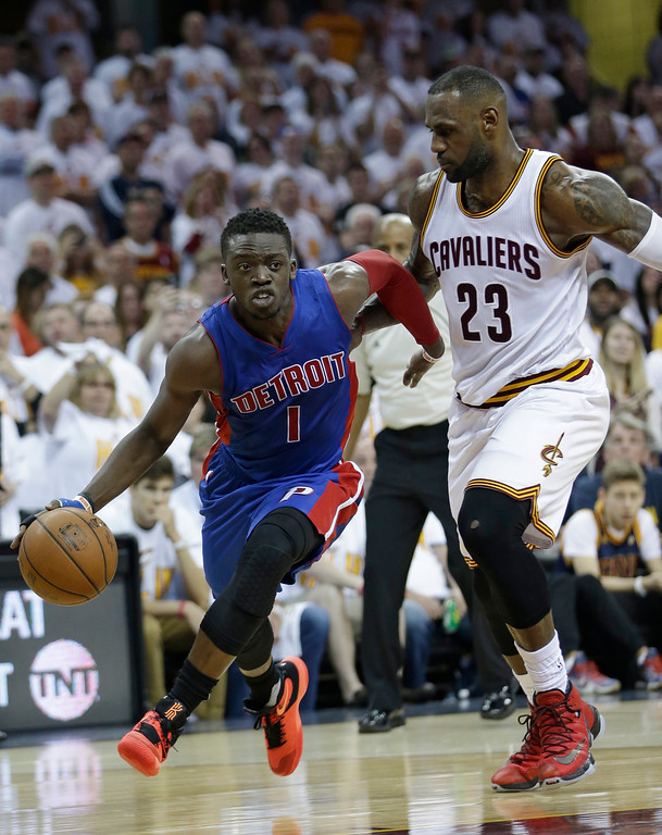 . Detroit Pistons\' Reggie Jackson (1), from Italy, drives past Cleveland Cavaliers\' LeBron James (23) in the second half in Game 1 of a first-round NBA basketball playoff series, Sunday, April 17, 2016, in Cleveland. The Cavaliers won 106-101.(AP Photo/Tony Dejak)