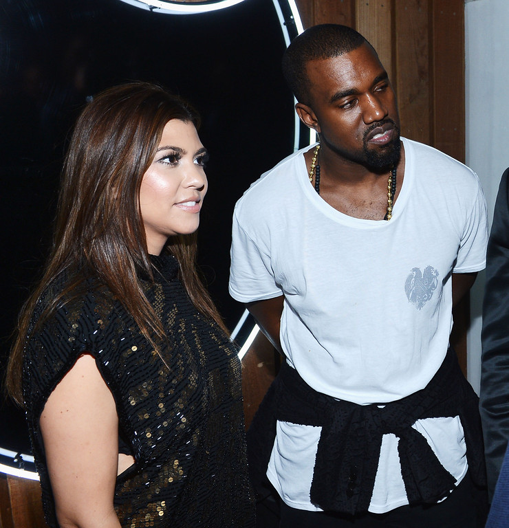 . MIAMI BEACH, FL - DECEMBER 06:  Kourtney Kardashian and Kanye West attend the celebration of Dom Perignon Luminous Rose at Wall at W Hotel on December 6, 2012 in Miami Beach, Florida.  (Photo by Dimitrios Kambouris/Getty Images for Dom Perignon)