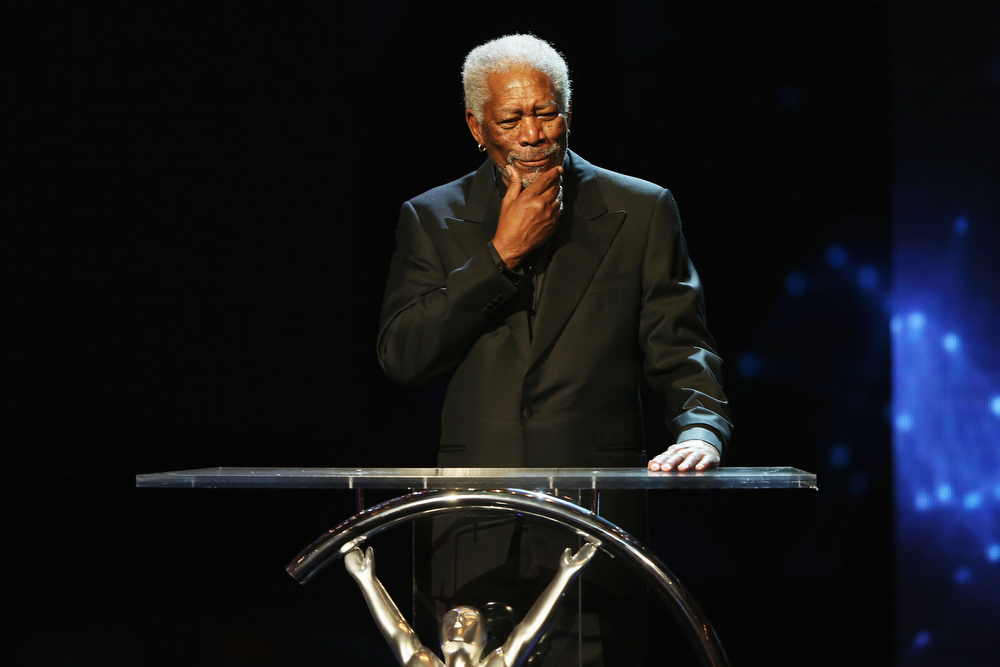 . Host Morgan Freeman speaksduring the awards show for the 2013 Laureus World Sports Awards at the Theatro Municipal Do Rio de Janeiro on March 11, 2013 in Rio de Janeiro, Brazil.  (Photo by Ian Walton/Getty Images For Laureus)