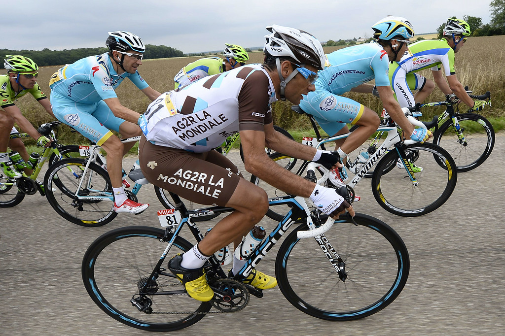 . France\'s Jean-Christophe Peraud (C) rides in the pack during the 234.5 km seventh stage of the 101st edition of the Tour de France cycling race on July 11, 2014 between Epernay and Nancy, northeastern France.  AFP PHOTO / LIONEL  BONAVENTURE/AFP/Getty Images