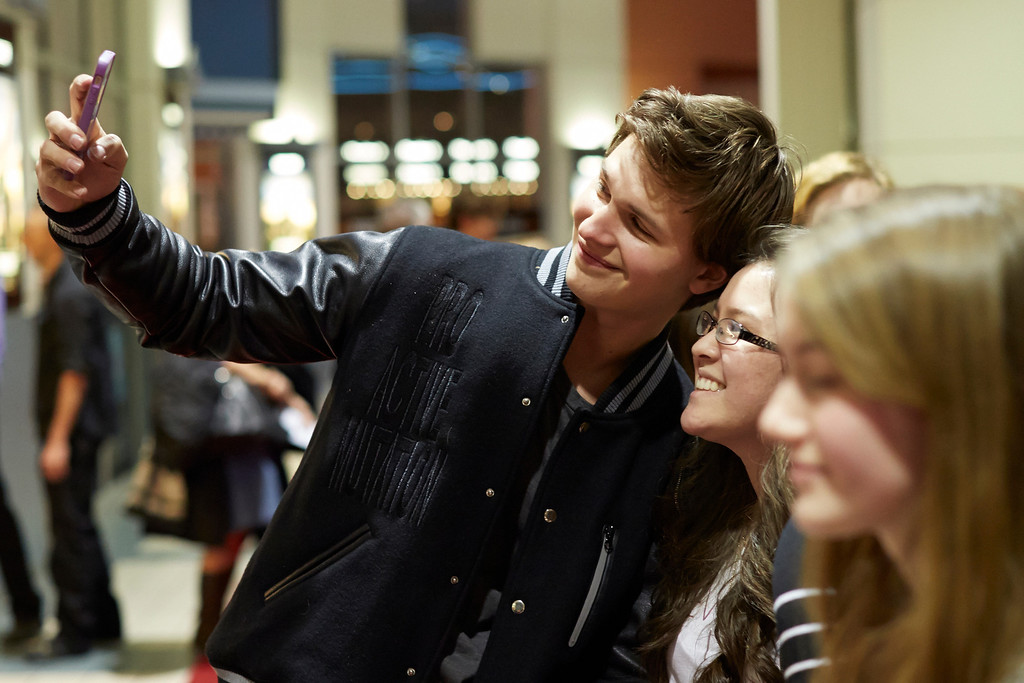 """. \""""Divergent\""""  actor Ansel Elgort greets fans on the red carpet at Mall of America on March 5, 2014 in Bloomington, Minnesota. (Photo by Adam Bettcher/Getty Images)"""