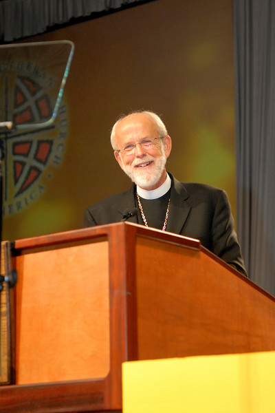 Bishop Mark Hanson coming to the podium after his re-election during the ELCA 2007 Churchwide Assembly.