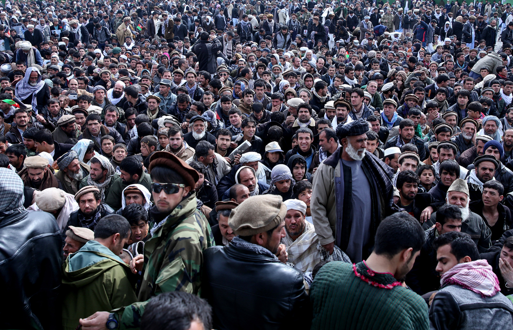 . Afghan men attend the burial of Afghanistan\'s influential Vice President Mohammad Qasim Fahim during his funeral procession in Kabul, Afghanistan, Tuesday, March 11, 2014. (AP Photo/Massoud Hossaini)