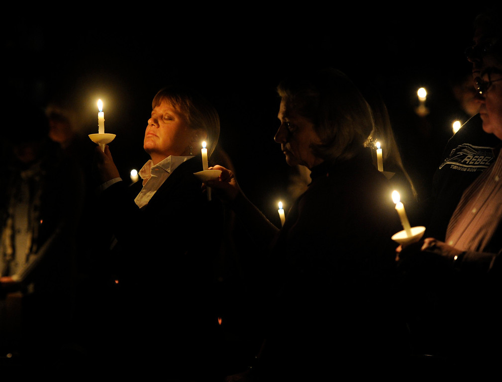 . The University Park United Methodist Church hosts a candlelight vigil on Sat., Dec. 15, 2012 to gather and pray and to memorialize those involved in the Connecticut school shooting. Kathryn Scott Osler, The Denver Post