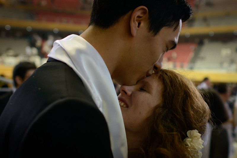 ". A newly-wed couple embrace following a mass wedding event held by the Unification Church in Gapyeong on February 12, 2014. Unification Church members forming 2500 couples from 52 countries were married in a mass wedding in South Korea -- only the second such event since the death of their ""messiah\"" and controversial church founder Sun Myung Moon. (ED JONES/AFP/Getty Images)"