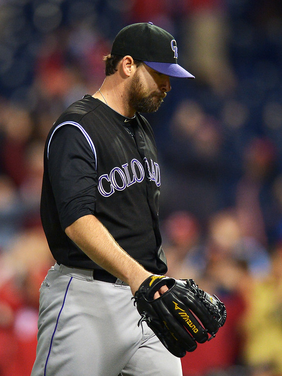 . Boone Logan #48 of the Colorado Rockies walks off the mound after giving up a home run to the Philadelphia Phillies in the ninth inning at Citizens Bank Park on May 28, 2014 in Philadelphia, Pennsylvania.  (Photo by Drew Hallowell/Getty Images)