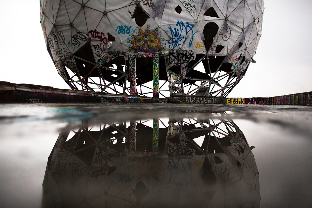 . In this Oct. 16, 2014 photo, the ruin of a vandalized, golf ball-shaped cover for antennas of the abandoned former listening station of the United States National Security Agency, at the Teufelsberg (Devil\'s Mountain) is reflected in a puddle in Berlin. The listening station, which was active until the early \'90s, is now used by graffiti artists and can be visited only with guided tours. (AP Photo/Markus Schreiber)