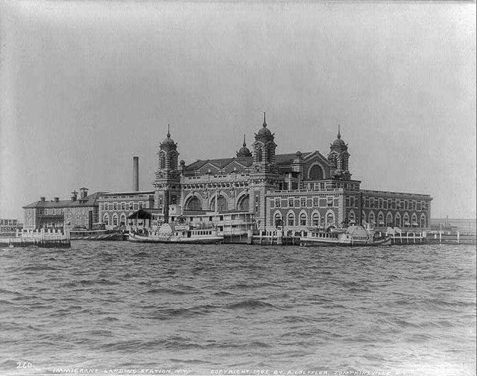 """. Ellis Island in 1905 On December 17, 1900, a magnificent new building opened on Ellis Island, to inspect and \""""process\"""" immigrants. Designed to handle approximately 500,000 people a year, it quickly proved to be inadequate for the numbers of of immigrants flooding into the United States from all parts of the world. (NPS Photo)"""