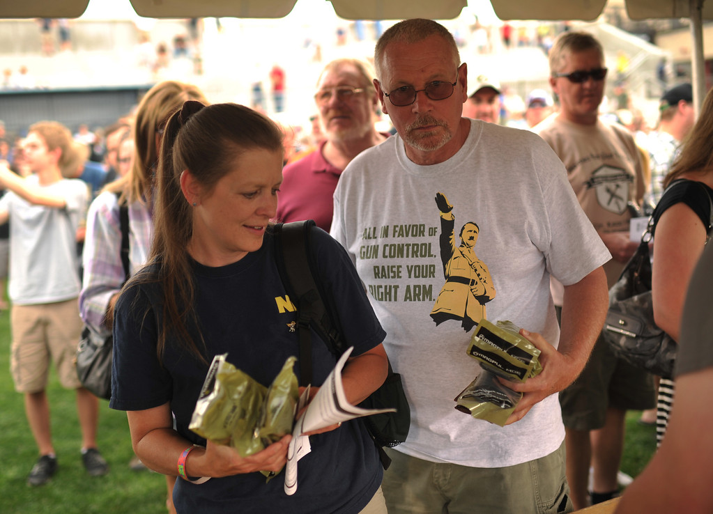 . GLENDALE, CO. - June 29: Susan Feeley, left, and her husband Mel of Colorado Springs are receiving the  30-round gun magazines at a farewell to arms freedom festival by Free Colorado in Infinity Park. Glendale, Colorado. June 29, 2013. Magpul Industries attended the party and handed out 1500 of their 30-round gun magazines for free.  (Photo By Hyoung Chang/The Denver Post)