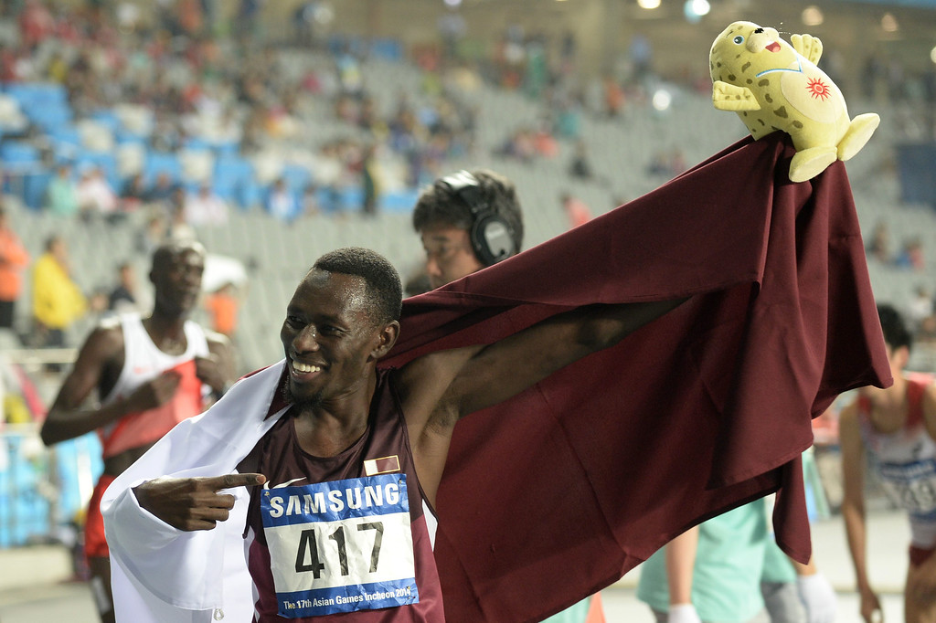 . Qatar\'s Abubaker Ali Kamal celebrates winning the final of the men\'s 3000m steeplechase athletics event during the 17th Asian Games at the Incheon Asiad Main Stadium in Incheon on September 29, 2014.  MANAN VATSYAYANA/AFP/Getty Images