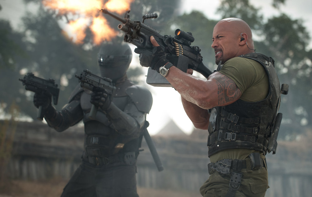 Description of . Left to right: Ray Park plays Snake Eyes and Dwayne Johnson plays Roadblock in G.I. JOE: RETALIATION, from Paramount Pictures, MGM, and Skydance Productions. (Jaimie Trueblood/Paramount Pictures)