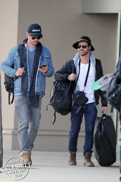 EXCLUSIVE: Chris Hemsworth Lands In Vancouver In Double Denim + A 60's Mustache!