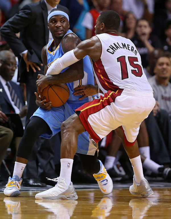 . MIAMI, FL - MARCH 14:  Ty Lawson #3 of the Denver Nuggets is defended by Mario Chalmers #15 of the Miami Heat during a game  at American Airlines Arena on March 14, 2014 in Miami, Florida. (Photo by Mike Ehrmann/Getty Images)