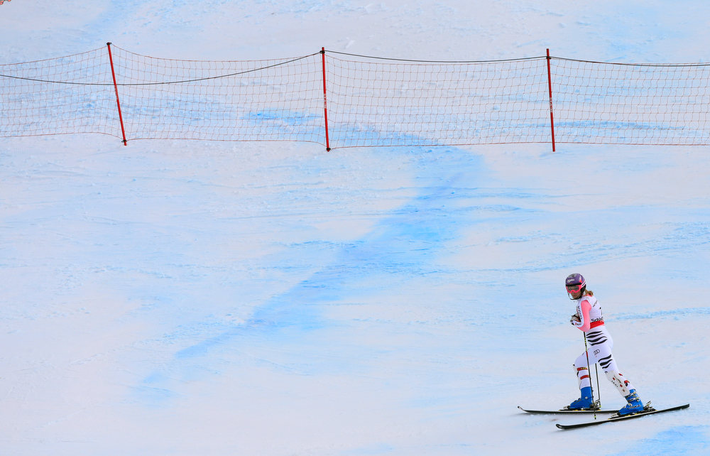 Description of . Germany's Maria Hoefl-Riesch reacts after missing a gate during the women's slalom at the 2013 Ski World Championships in Schladming, Austria on February 16, 2013.  ALEXANDER KLEIN/AFP/Getty Images