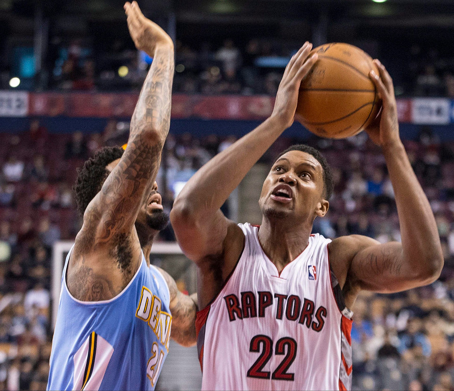 . Toronto Raptors\' Rudy Gay, right, shoots as Denver Nuggets\' Wilson Chandler defends during the second half of an NBA basketball game on Sunday, Dec. 1, 2013, in Toronto. (AP Photo/The Canadian Press, Chris Young)