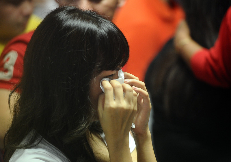 . Relatives of passengers on AirAsia flight QZ 8501 react to the breaking news of debris and bodies being found on December 30, 2014 in Surabaya, Indonesia. Debris and dead bodies have reportedly been sighted in the Java Sea during search operations for the missing AirAsia flight QZ 8501. AirAsia flight QZ8501 from Surabaya to Singapore, with 162 people on board, lost contact with air traffic control at 07:24 a.m. local time on December 28.  (Photo by Robertus Pudyanto/Getty Images)
