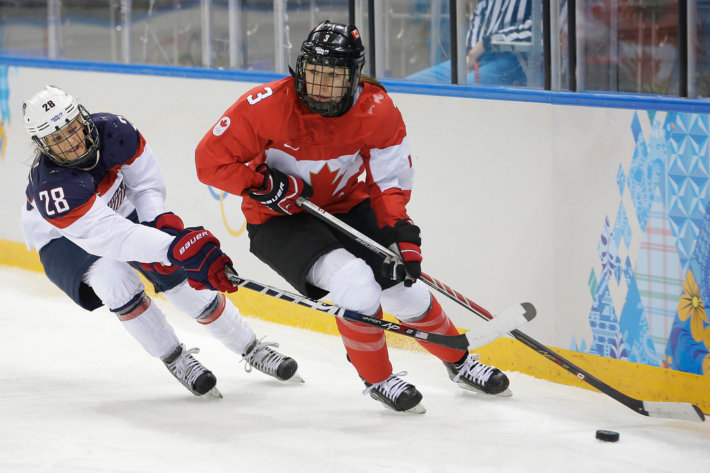 . Amanda Kessel of the United States attacks Jocelyne Larocque of Canada during the first period of the 2014 Winter Olympics women\'s ice hockey game at Shayba Arena, Wednesday, Feb. 12, 2014, in Sochi, Russia. (AP Photo/Matt Slocum)