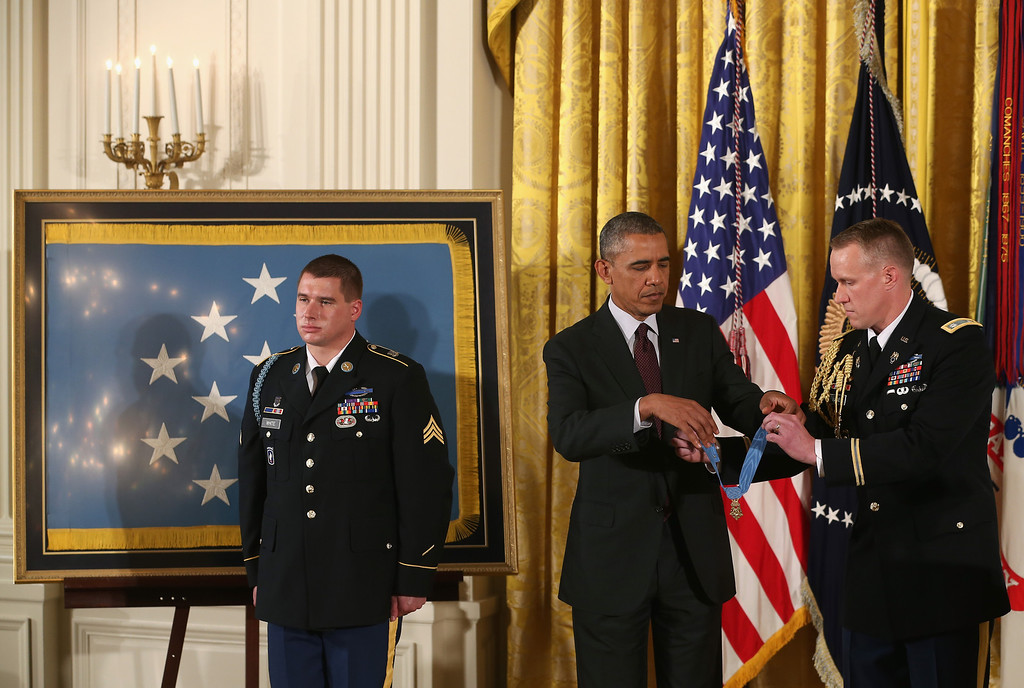 . U.S. President Barack Obama (C) awards the Medal of Honor to U.S. Army Sgt. Kyle J. White (L) during a ceremony in the East Room of the White House May 13, 2014 in Washington, DC.   (Photo by Mark Wilson/Getty Images)
