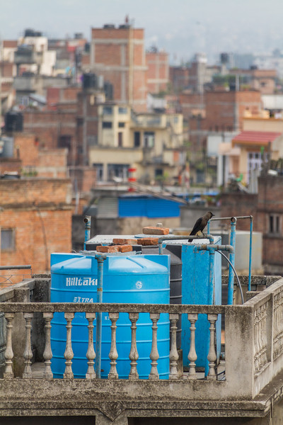 Water storage tanks on the rooftops of homes - Nepal