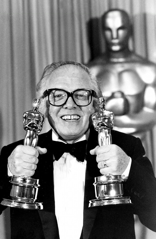 ". In this Monday, April 11, 1983 file photo, British actor and director Richard Attenborough holds his two Oscars for his epic movie ""Gandhi\"" at the 55th annual Academy Awards in Los Angeles, Ca.,. Acclaimed actor and Oscar-winning director Richard Attenborough, whose film career on both sides of the camera spanned 60 years, died on Sunday, Aug. 24, 2014. He was 90. (AP Photo, File)"