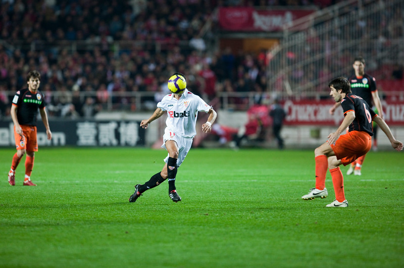 Renato pursues the ball watched by Albelda. Spanish Liga game between Sevilla FC and Valencia CF. Sanchez Pizjuan stadium, Seville, Spain, 31 January 2010