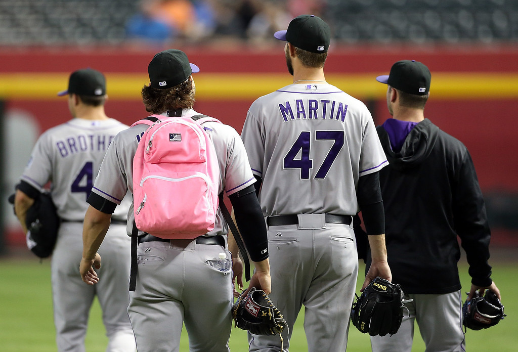 . Pitcher Tommy Kahnle #54 (second from left) of the Colorado Rockies walks out to the bullpen with teammates before the MLB game against the Arizona Diamondbacks at Chase Field on April 30, 2014 in Phoenix, Arizona.  (Photo by Christian Petersen/Getty Images)