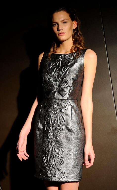 . A model wears a creation for Dutch fashion designer Iris van Herpen\'s ready-to-wear Spring/Summer 2014 fashion collection, presented in Paris, Tuesday, Oct.1, 2013. (AP Photo/Zacharie Scheurer)