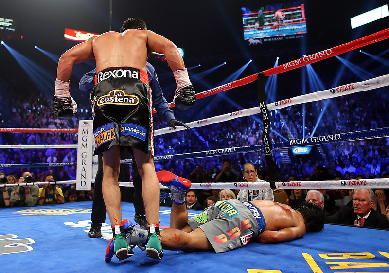 . Manny Pacquiao lays face down on the mat after being knocked out in the sixth round by Juan Manuel Marquez during their welterweight bout at the MGM Grand Garden Arena on December 8, 2012 in Las Vegas, Nevada.  (Photo by Al Bello/Getty Images)