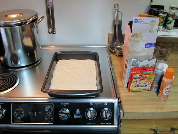 The process begins with a regular white cake mix (left).  On the right are some of the supplies that will be used to decorate the cake.