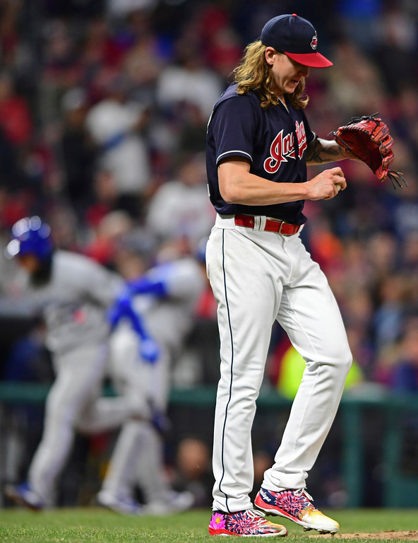 . Cleveland Indians starting pitcher Mike Clevinger waits for Toronto Blue Jays\' Aledmys Diaz to run the bases after hitting a three-run home run during the fourth inning of a baseball game Friday, April 13, 2018, in Cleveland. (AP Photo/David Dermer)
