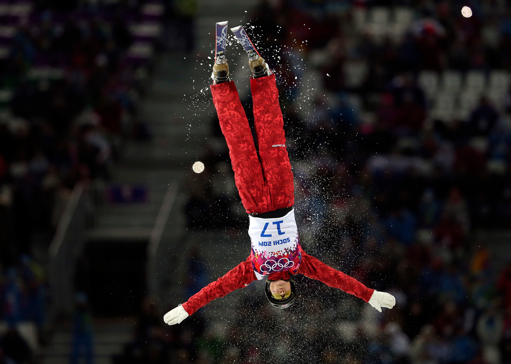 . Russia\'s Assoli Slivets jumps during the women\'s freestyle skiing aerials qualifying at the Rosa Khutor Extreme Park, at the 2014 Winter Olympics, Friday, Feb. 14, 2014, in Krasnaya Polyana, Russia. (AP Photo/Sergei Grits)