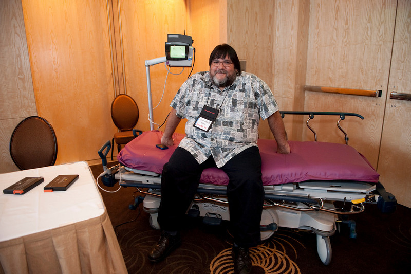 A representative from FiReStar company Hoana Medical Inc. (Honolulu) demonstrates the LifeBed Vigilance System