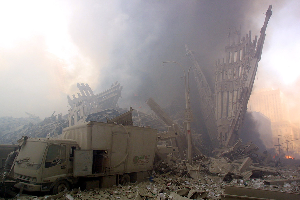 . A truck sits in the rubble in lower Manhattan 11 September, 2001, in New York after two planes flew into the World Trade Center twin towers.  AFP PHOTO  Doug KANTER/AFP/Getty Images