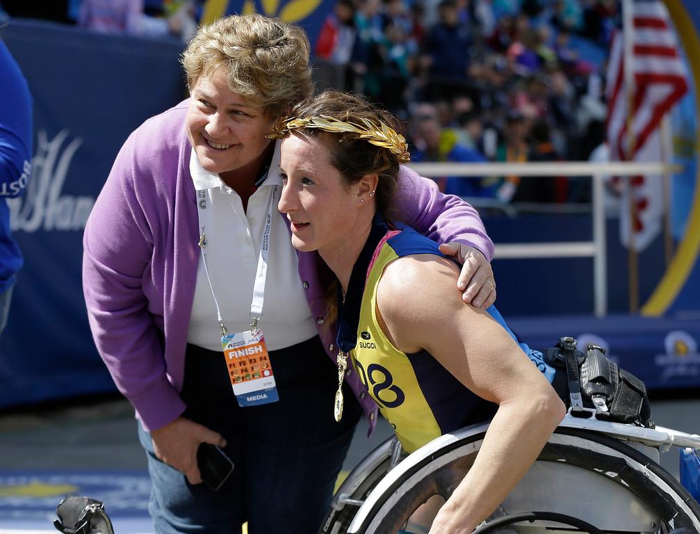 . Tatyana McFadden, of Clarksville, Md., poses with her mother Deborah after winning the women\'s wheelchair division of the 120th Boston Marathon on Monday, April 18, 2016, in Boston. (AP Photo/Elise Amendola)