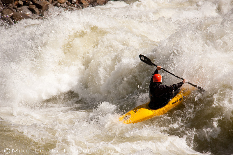 """Paddler Brian Ward in """"Bouncer Down the Middle"""" on the North Fork Payette River, Idaho. 6,500-7,000cfs"""
