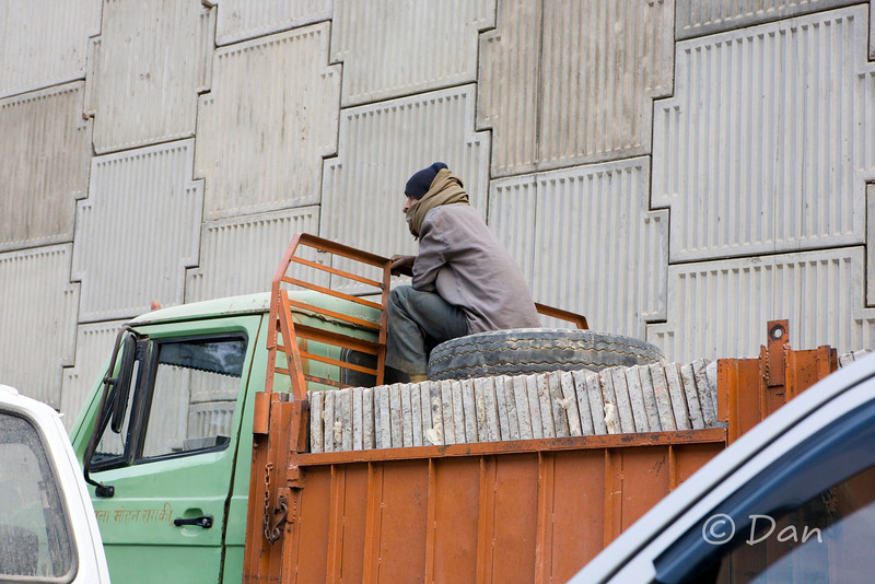 guy sitting on a truck on the street