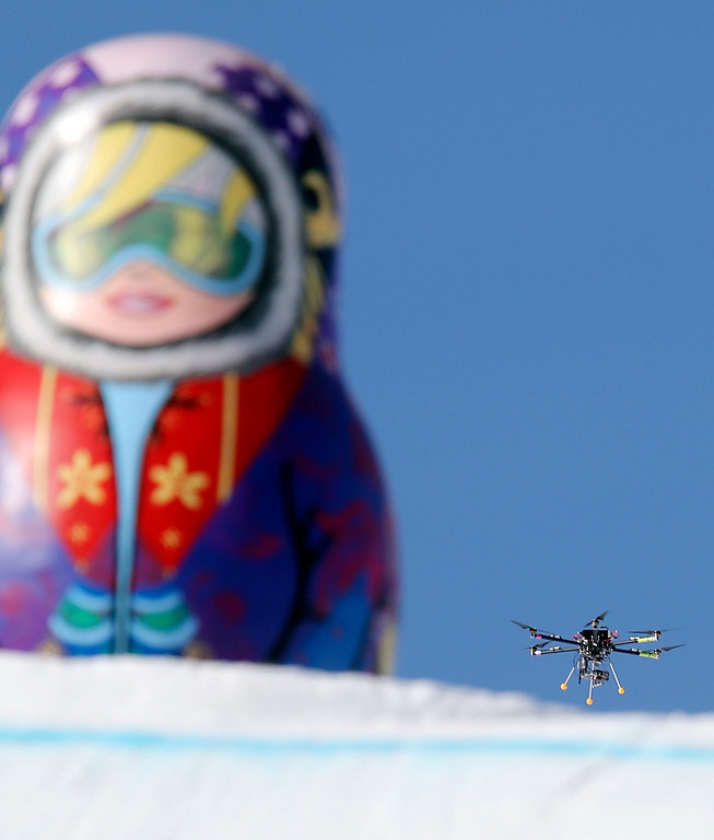 . In this Friday Feb. 7 photo, a drone camera  flies about the slopestyle course during a freestyle skiing slopestyle training session at the Rosa Khutor Extreme Park ahead of the 2014 Winter Olympics, Friday, Feb. 7, 2014, in Krasnaya Polyana, Russia. (AP Photo/Sergei Grits)