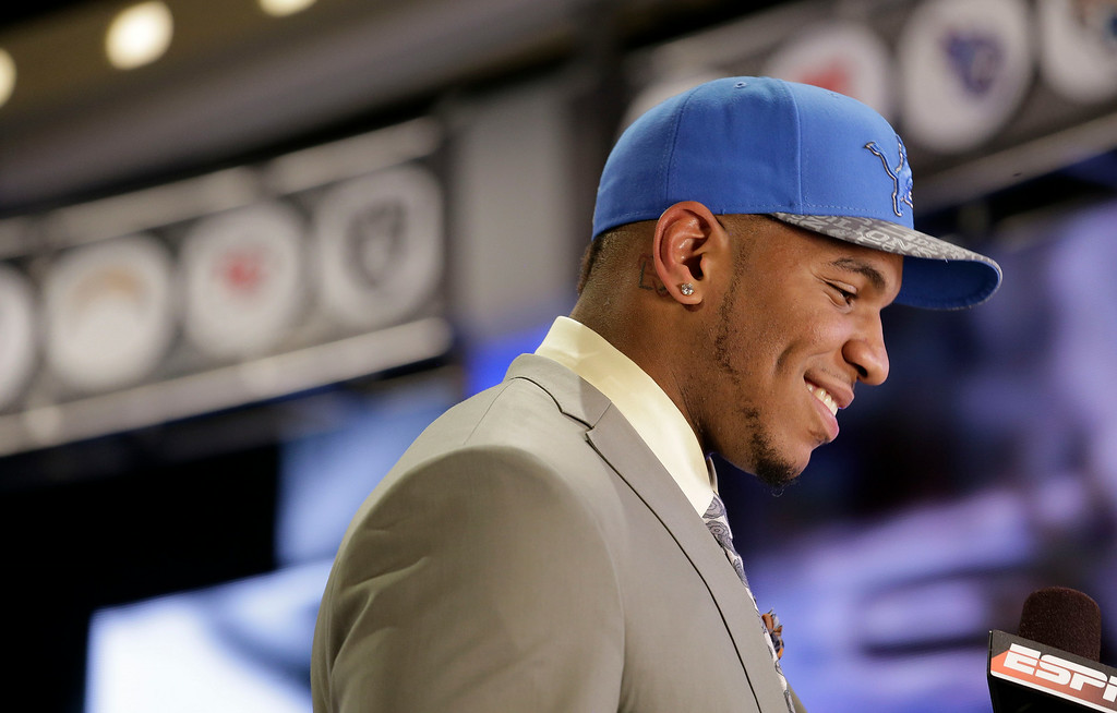 . North Carolina tight end Eric Ebron walks off the stage after being selected by the Detroit Lions as the 10th pick in the first round of the 2014 NFL Draft, Thursday, May 8, 2014, in New York. (AP Photo/Craig Ruttle)