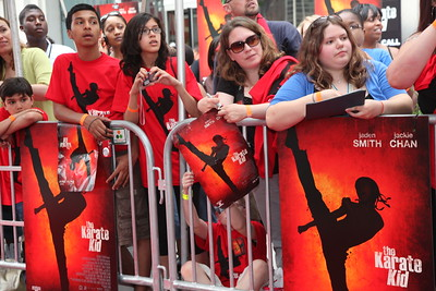Fans wait for film stars Jaden Smith (son of Will Smith) and Jackie Chan to walk the red carpet for the Chicago screening of the Karate Kid at the AMC River East 21 in Chicago, IL,  USA on Wednesday 26, May 2010.