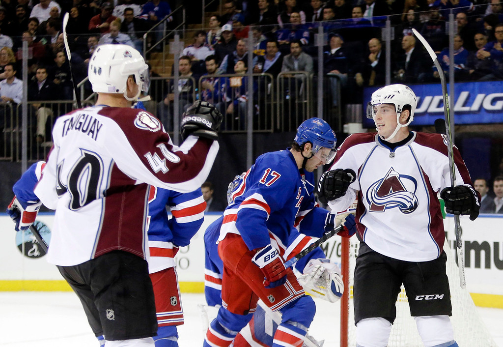 . Colorado Avalanche\'s Matt Duchene, right, celebrates with teammate Alex Tanguay (40) after scoring a goal during the first period of an NHL hockey game against the New York Rangers, Thursday, Nov. 13, 2014, in New York. (AP Photo/Frank Franklin II)