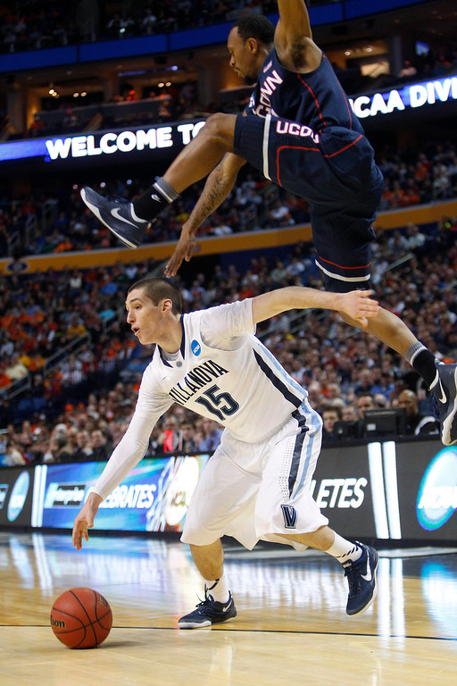 . Villanova\'s Ryan Arcidiacono (15) drives under Connecticut\'s Ryan Boatright during the first half of a third-round game in the NCAA men\'s college basketball tournament in Buffalo, N.Y., Saturday, March 22, 2014. (AP Photo/Bill Wippert)