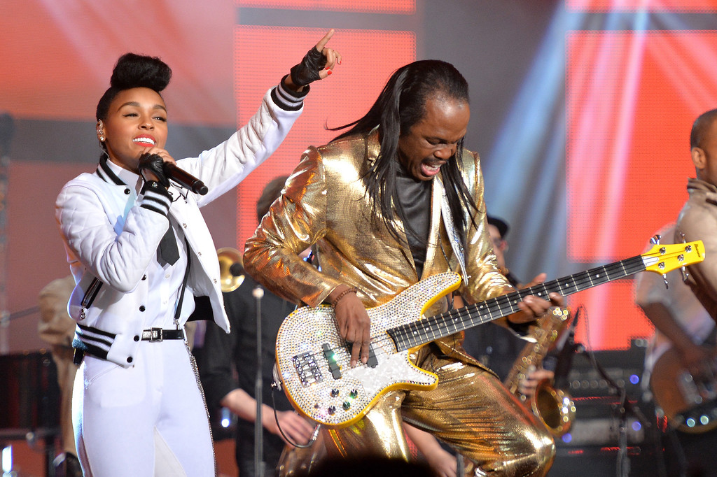 . Musician Janelle Monae (L) and Verdine White of Earth, Wind & Fire perform onstage at the 63rd NBA All-Star Game 2014 at the Smoothie King Center on February 16, 2014 in New Orleans, Louisiana.  (Photo by Mike Coppola/Getty Images)