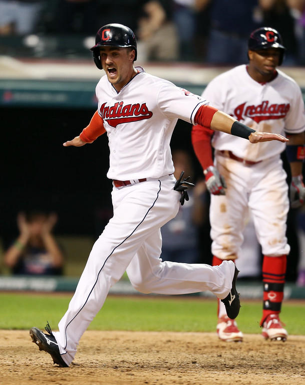 . Cleveland Indians\' Lonnie Chisenhall celebrates as he scores the game-winning run against the Texas Rangers on a single by Yan Gomes during the 11th inning of a baseball game Wednesday, June 1, 2016, in Cleveland. The Indians won 5-4. (AP Photo/Ron Schwane)