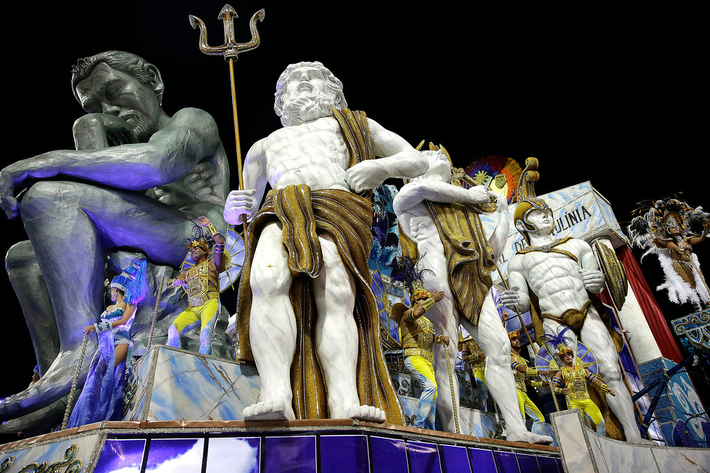 . Dancers from the Vai-Vai samba school perform on a float during a carnival parade in Sao Paulo, Brazil, Saturday, March 1, 2014. (AP Photo/Andre Penner)