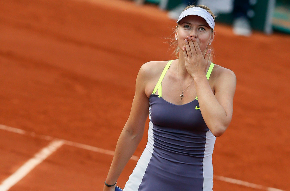 . Russia\'s Maria Sharapova celebrates after winning her French tennis Open first round match on May 27, 2013 at the Roland Garros stadium in Paris.  PATRICK KOVARIK/AFP/Getty Images