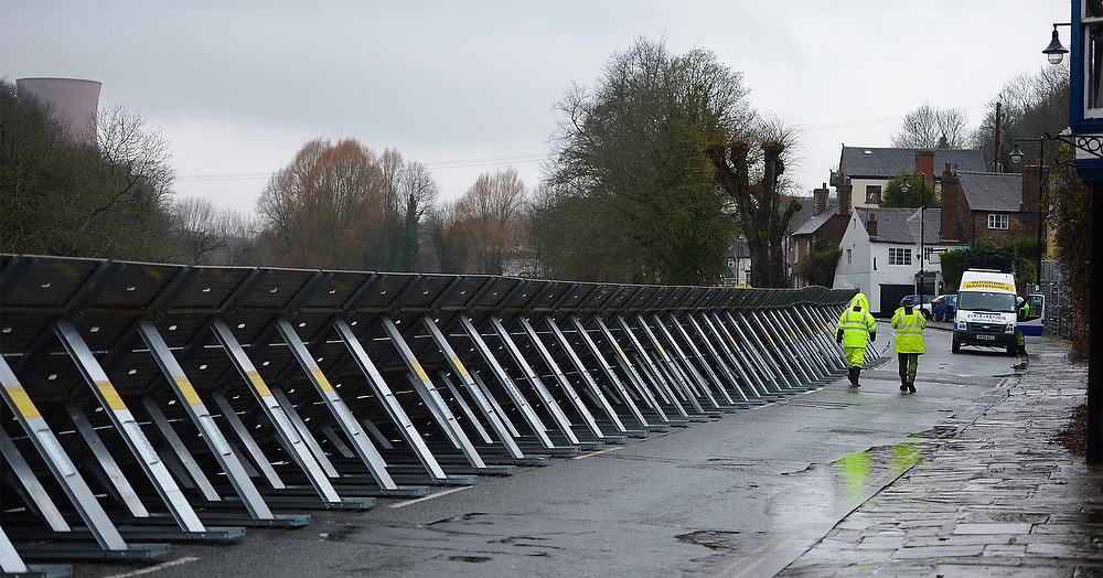 . Workers erect flood barriers alongside the swollen River Severn at Ironbridge near Telford in Shropshire on December 24, 2012. Heavy flooding across parts of Britain caused widespread road and rail disruption, wreaking havoc on Christmas travel plans while rescuers worked to evacuate people from the hardest-hit communities. ANDREW YATES/AFP/Getty Images