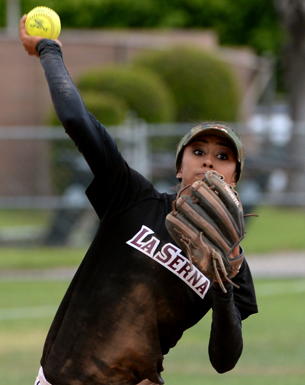 . La Serna\'s Taylor Becerra throws out Bishop Amat\'s Julia Valenzuela (not pictured) in the third inning of a prep playoff softball game at Bishop Amat High School in La Puente, Calif., on Thursday, May 22, 2014. La Serna won 6-0.   (Keith Birmingham/Pasadena Star-News)