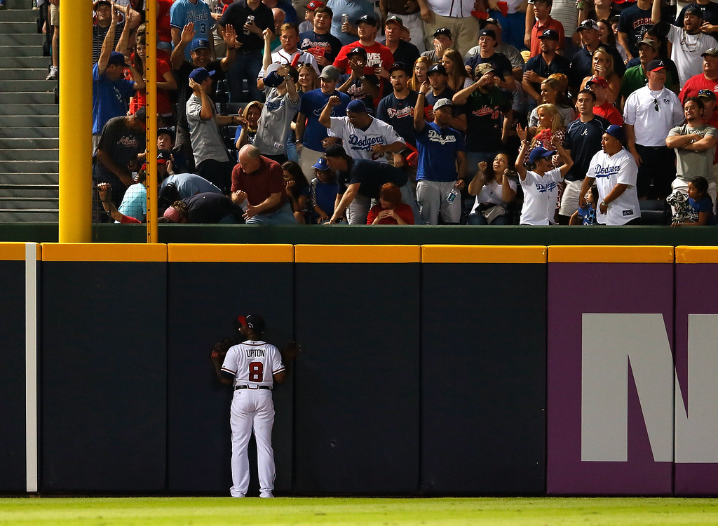 . ATLANTA, GA - OCTOBER 04: Justin Upton #8 of the Atlanta Braves looks up after a two-run homer by Hanley Ramirez #13 outfield the Los Angeles Dodgers in the eighth inning during Game Two of the National League Division Series at Turner Field on October 4, 2013 in Atlanta, Georgia.  (Photo by Kevin C. Cox/Getty Images)
