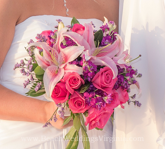 hot pink roses, stargazer lilies, plus purple and lavender